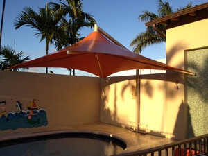orange Skyspan Umbrella porch